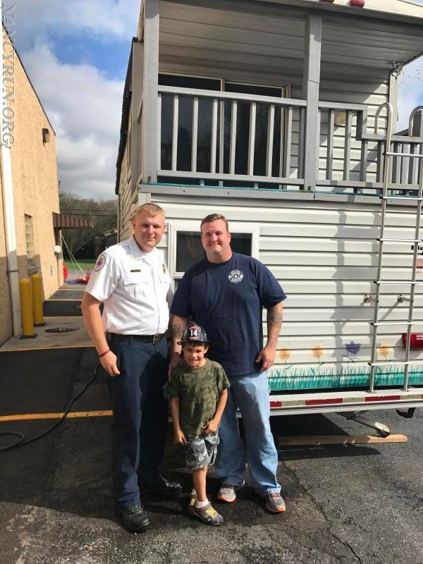 First Assistant Chief N. Rampulla with Former Assistant Chief Zach Austin, and his son.