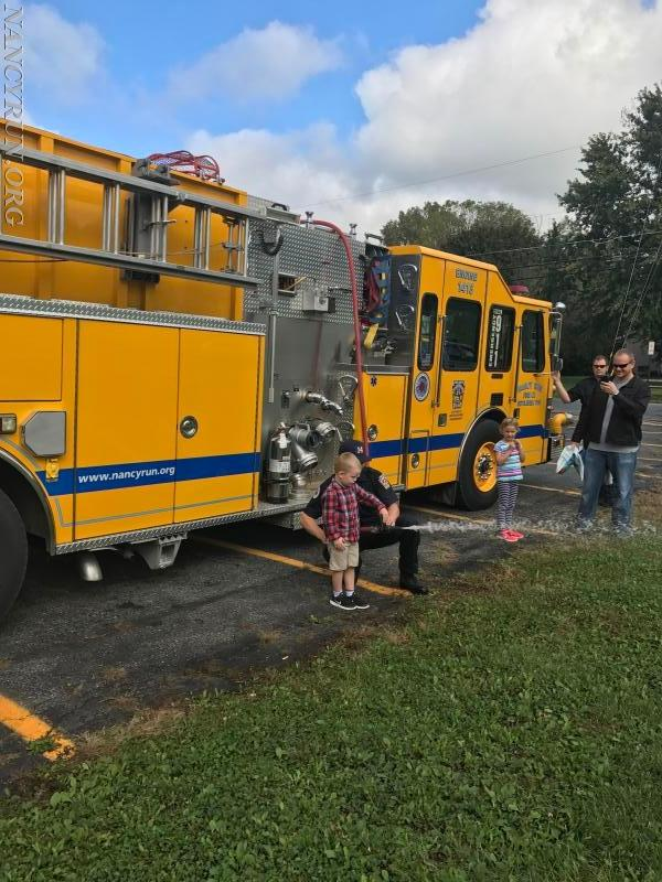 Probationary Firefighter Thompson teaching young aspiring Nozzlemen.